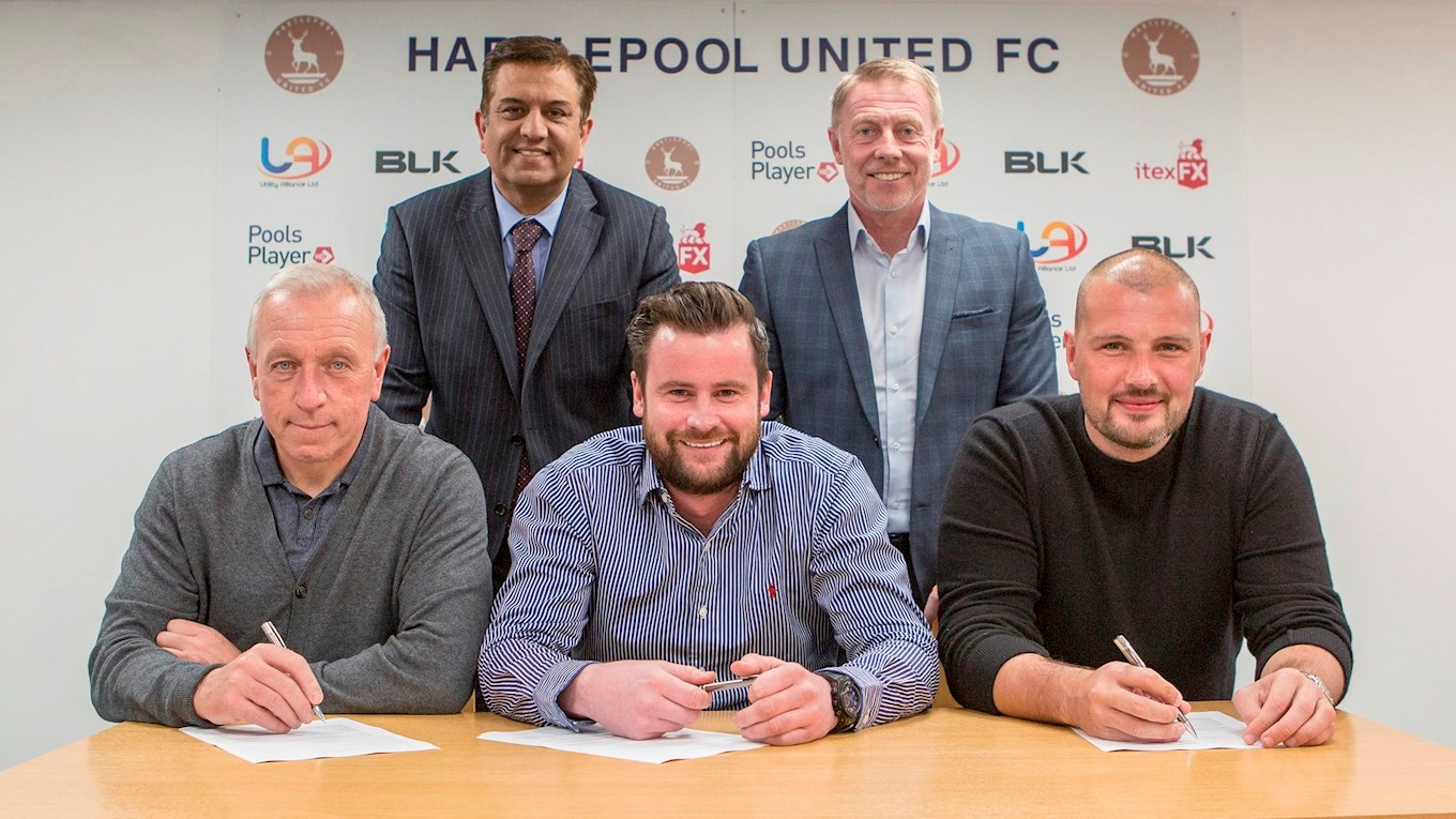 Raj Singh and Craig Hignett watch on as Ged McNamee, Matthew Bates and Ross Turnbull sign deals