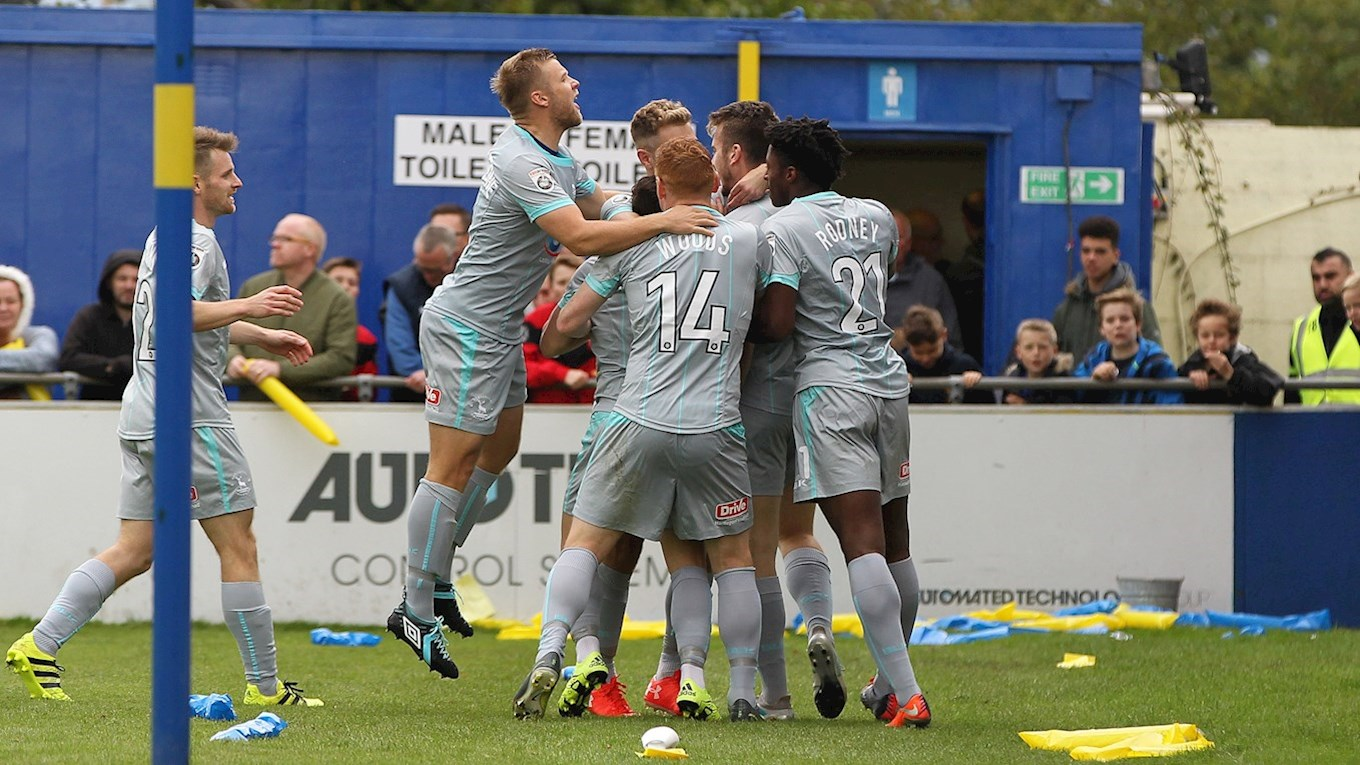 The players celebrate the goal