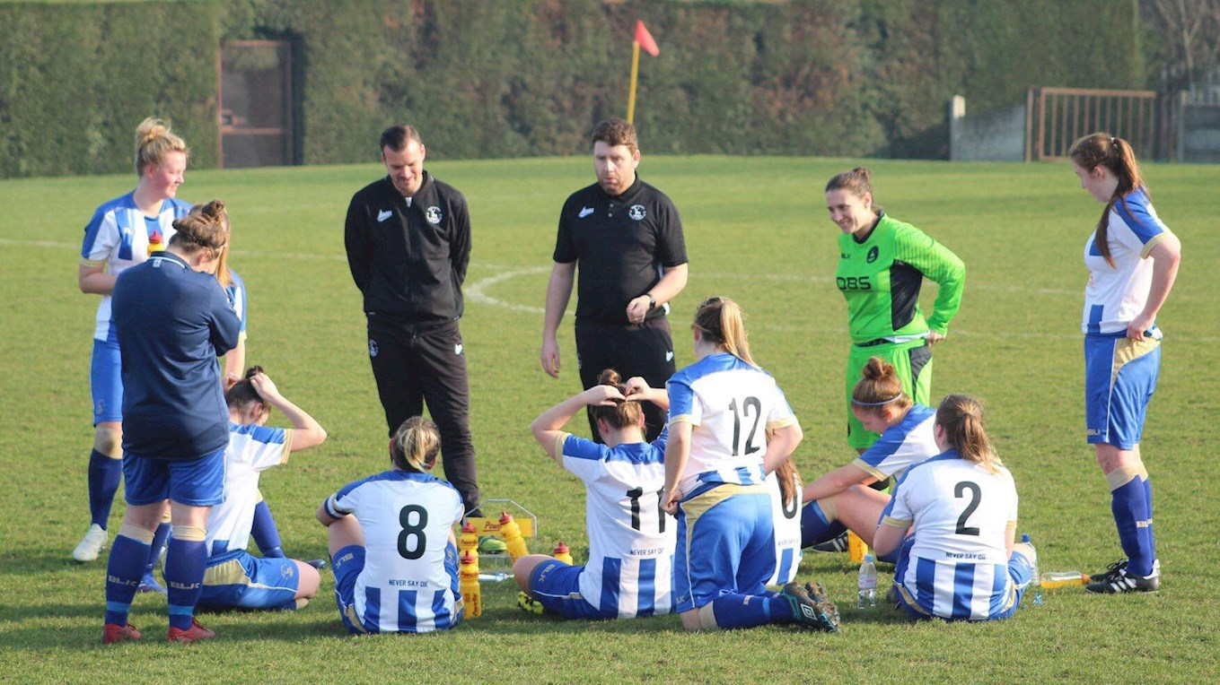 Women's Team management team Andy Hetherington and Jonathan Gibbon-Hayes talk to the players